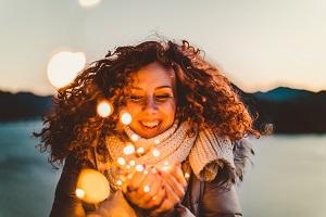smiling-woman-lights-inspire-positivity
