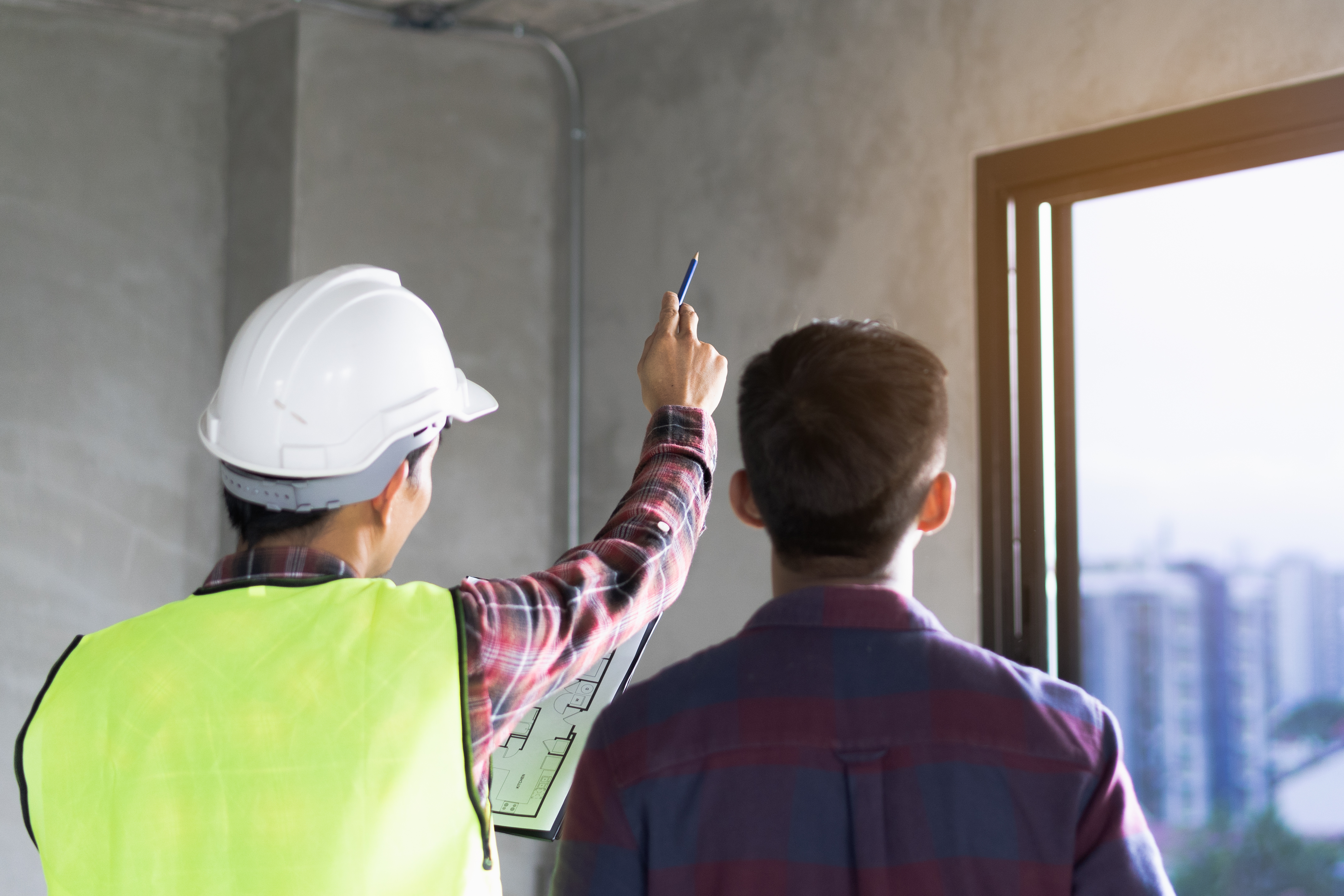 home-inspector-pointing-out-costly-issues-with-home
